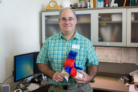 Weinthal with his 3-D printed hands meant to be training wheels for a real prosthetic hand. Andrew Fraieli | Opinions Editor
