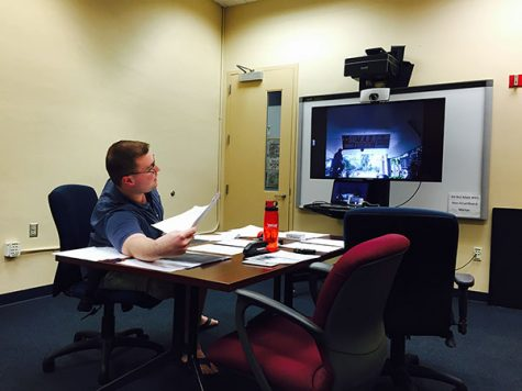 Ryan Klimar, the marketing director for the Elections Board, video chats with Gregory Barber as they sort through contestations. Photo by Gregory Cox | Managing Editor