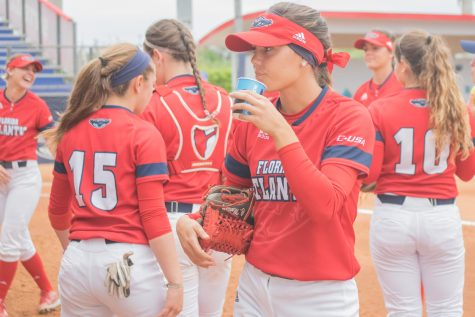 Christina Martinez takes a sip of water before taking the field against Louisiana Tech. Ryan Lynch | Multimedia Editor
