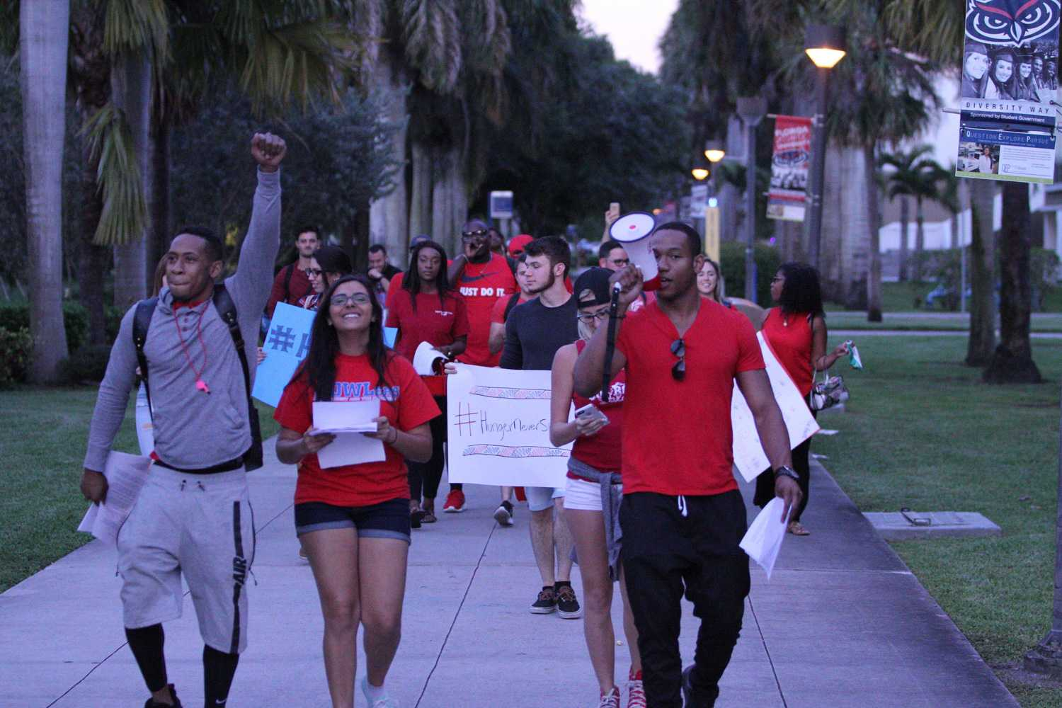 Rich Haughton (right) leads the protest toward the Atlantic Dining Hall. Brendan Feeney | Sports Editor