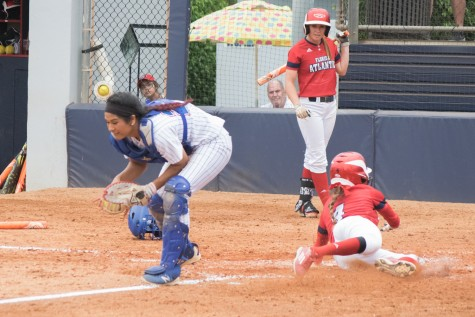 Senior outfielder Christina Martinez slides in safe after a sacrifice fly by her twin sister Melissa, scoring the first run of Sunday's game between the Owls and Louisiana Tech. Ryan Lynch | Multimedia Editor