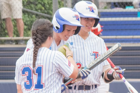 Anna Cross kisses her team's luck charm- a fake baby gator in an egg - after hitting a home run in the top of the fourth inning Sunday. The senior rightfielder had Louisiana Tech's only hit and run of the game. Ryan Lynch   Multimedia Editor