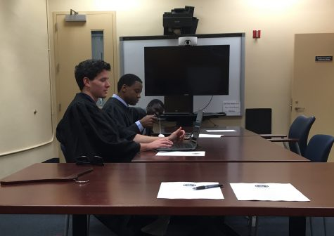 Members of the student court (left to right), Seamus Maloney, the Boca Raton associate justice, with Khalil Ricketts, the chief justice, and Saheed Oluwasina Oseni, Broward associate justice at the court meeting to hear Elections Chair Gregory Barber's defense for not fully completing his job duties. Photo by Gregory Cox | Managing Editor