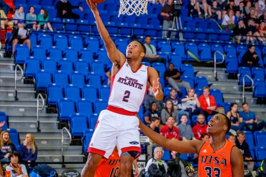 Junior guard Marquan Botley goes for a layup during the Owls' 79-73 win over UTSA on Feb. 11. Mohammed F Emran | Staff Photographer