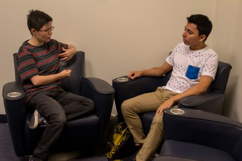 Roman Alexander talks with sophomore biology major Gerardo Ruiz in the LGBTQA center, Room 206 on the second floor of the Student Union. Photo by Andrew Fraieli