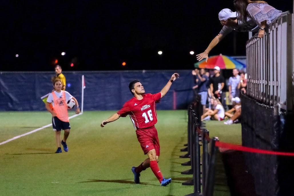 Senior forward Jason Fitzgerald celebrates after scoring a goal against Niagara on Sept. 2. Mohammed F. Emran | Staff Photographer