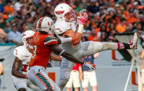 Owls linebacker Nate Ozdemir (50) intercepts a pass intended for Hurricanes wide receiver Stacy Coley (3) at Miami's 48-yard line in FAU's loss on Sept. 10. Max Jackson | Staff Photographer