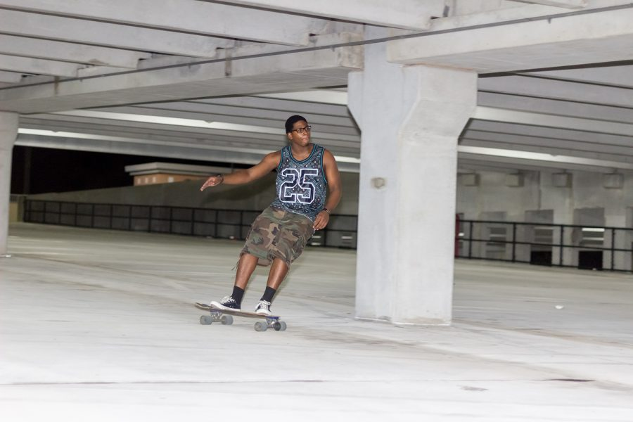 Raheem Rochester longboards down Parking Garage 2. Andrew Fraieli | Managing Editor