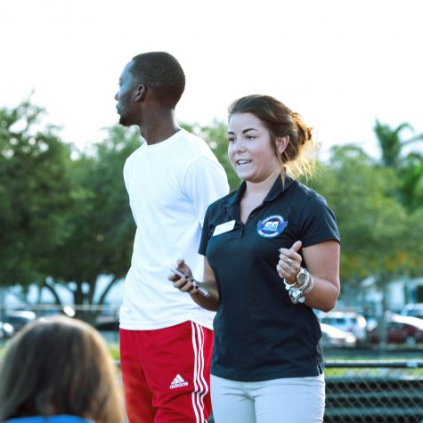 Kappa Alpha Psi President Javonte Wilkerson and Student Government director of government relations Jessica McMillan address the crowd of students at the FAU Track and Field Complex Friday. Patrick Delaney | Photo Editor