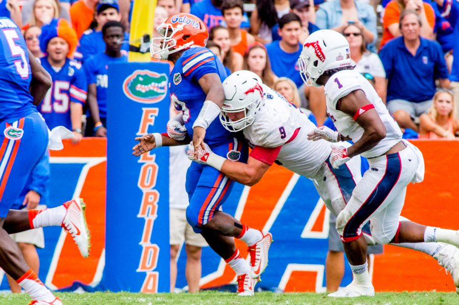 Trey Hendrickson sacks University of Florida quarterback Treon Harris in the fourth quarter of the Owls 2015 game versus the Gators, forcing Harris to fumble the ball. The sack allowed Hendrickson to tie the program record of 16 career sacks. Photo by Max Jackson