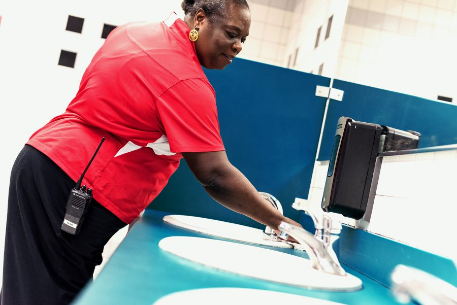 Joseph wipes off the sinks in one of the bathrooms in the Student Union while making her rounds. Patrick Delaney | Photo Editor