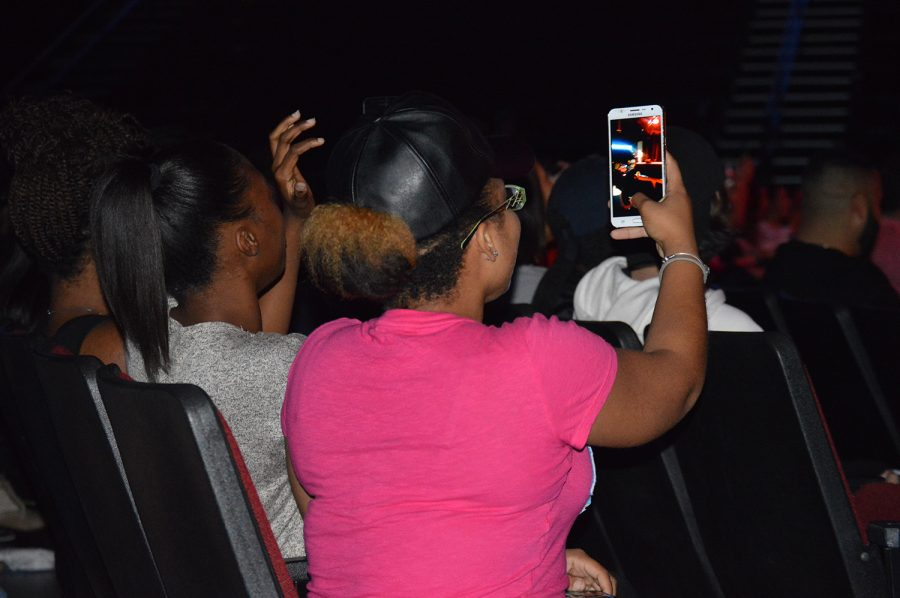A student takes a photo of the stage during the start of the drag show. Kaylyn Koutz | Contributing Photographer