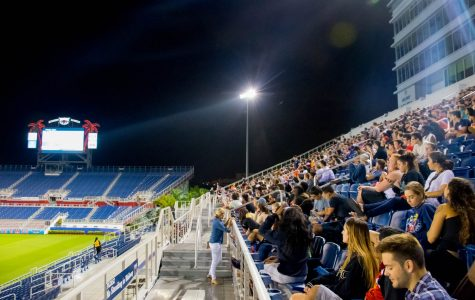 Students sit and wait for the start of the debate on the Jumbotron at FAU Stadium. Craig Ries | Contributing Photographer.