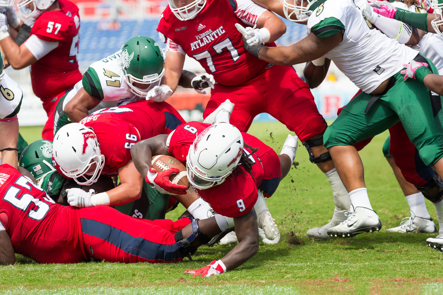 FAU junior running back Greg Howell (9) dives into the endzone. Howell had three touchdowns against Charlotte, making him the first FAU player to rush for three touchdowns in a single game since 2011.