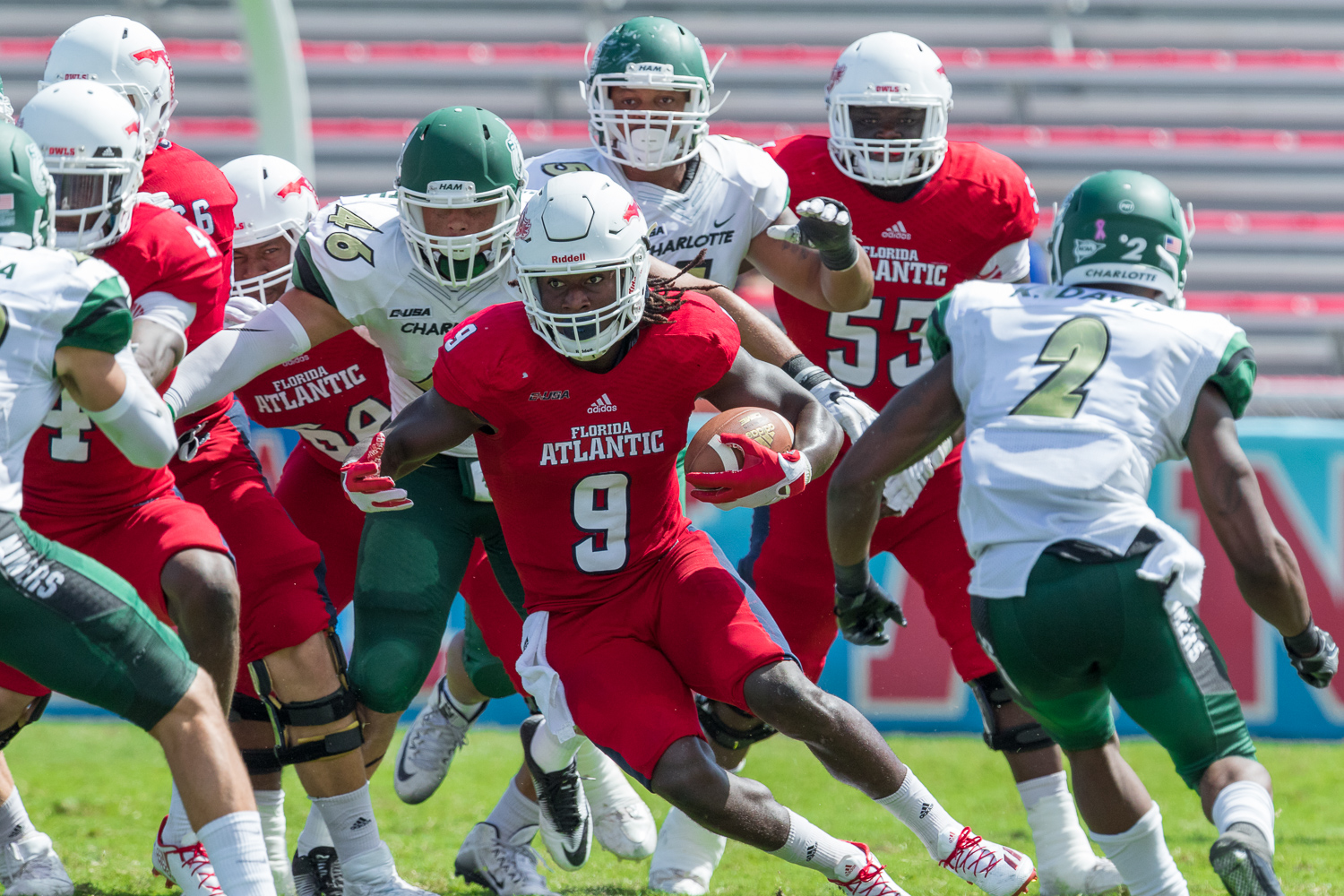 FAU junior running back Greg Howell (9) picks up yards in the game against the Charlotte 49ers Sunday.