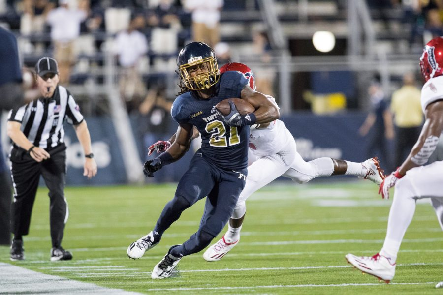 FIU freshman wide receiver Stantley Thomas (21) runs down the sidelines to gain a first down for the Panthers. Brandon Harrington | Staff Photographer