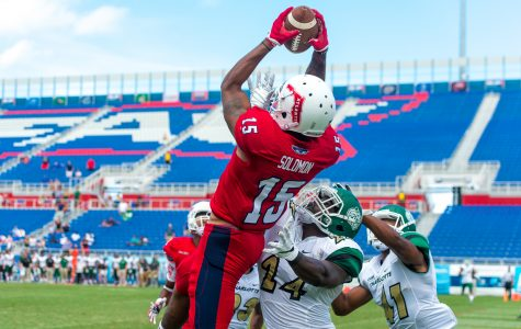 Junior wide receiver Kamrin Solomon catches a Hail Mary during the game's final seconds which would have given FAU the win. The play was overturned after a replay review. Max Jackson | Staff Photographer