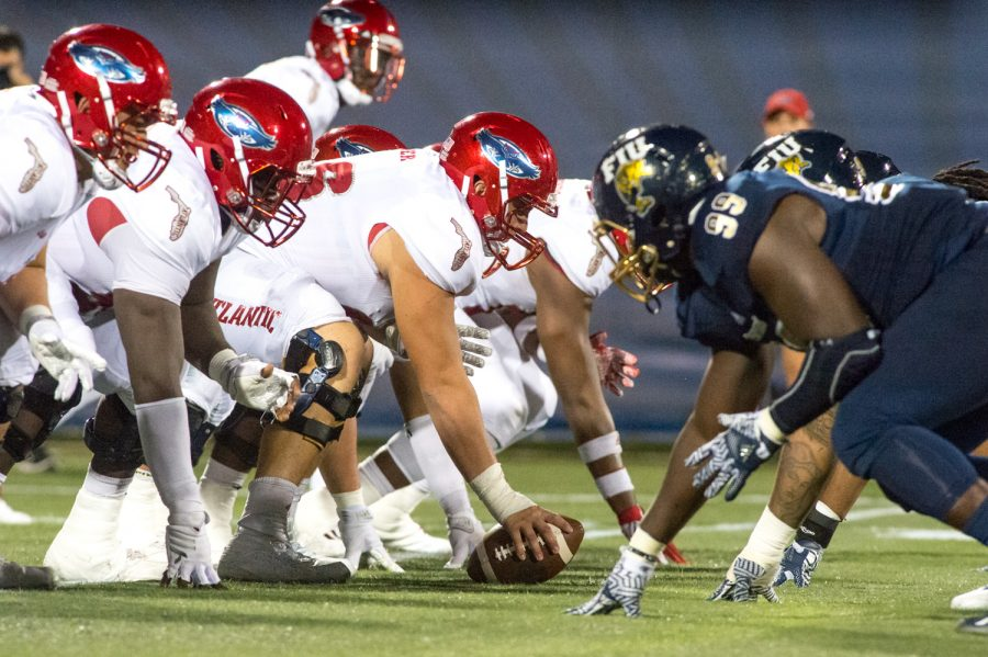 FAU's offense and FIU's defense set up before the play on the line of scrimmage during the 15th annual Shula Bowl. Max Jackson | Staff Photographer