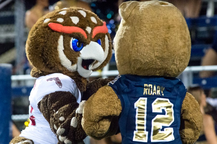 FAU's mascot Owsley and FIU's mascot Roary pretend to fight in the endzone during a break in the game. Max Jackson | Staff Photographer