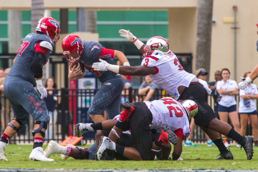 WKU junior defensive lineman Chris Johnson (3) sacks redshirt sophomore quarterback Jason Driskel (16) for a loss of 7 yards. Max Jackson | Staff Photographer