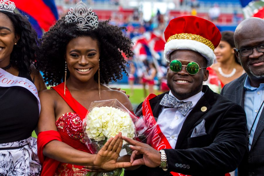 Homecoming king Wadly Estel and queen Fakaira Gabriel pose for a photo after being crowned for their respective roles at halftime. Max Jackson | Staff Photographer