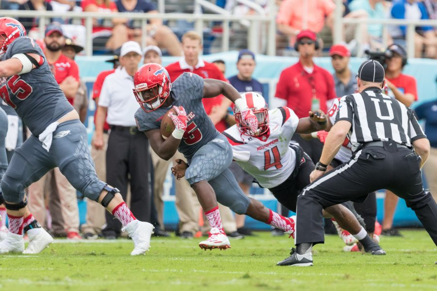 Hilltoppers sophomore linebacker Joel Iyiegbuniwe (4) dives to tackle FAU redshirt freshman running back Devin Singletary (5) as he tries to gain yards for the Owls. Brandon Harrington | Staff Photographer