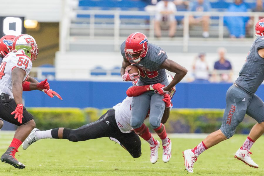 FAU freshman wide receiver John Mitchell (85) is stopped by Western Kentucky senior linebacker Drew Davis (34). Brandon Harrington | Staff Photographer
