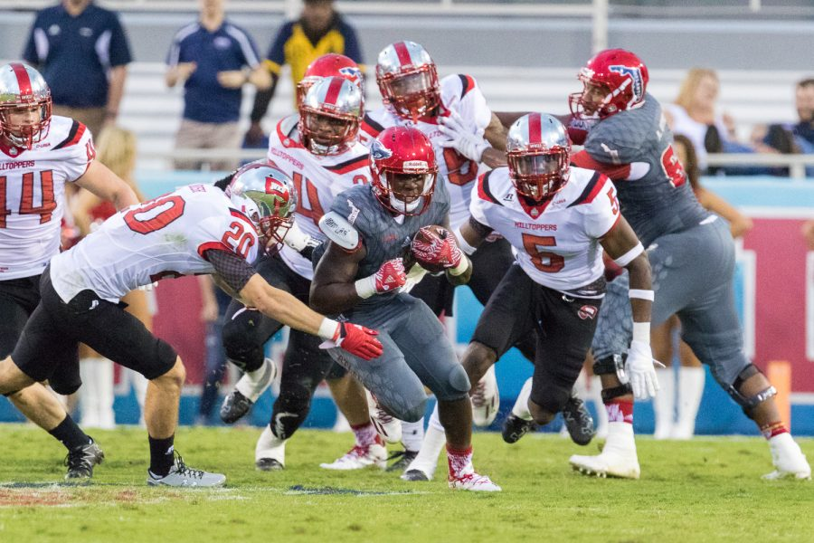 FAU redshirt freshman running back Devin Singletary (5) manages to break through the Western Kentucky defense late in the game on Saturday. Brandon Harrington | Staff Photographer