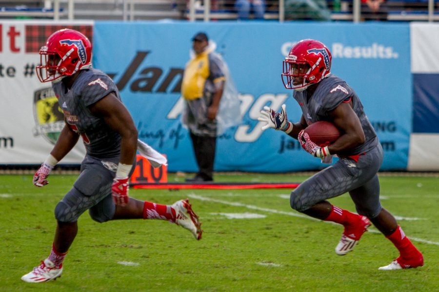 Redshirt freshman Kerrith Whyte runs after receiving a Hilltopper kickoff while freshman Devin Singletary (5) runs ahead to block defenders. Jonathan Scott | Contributing Photographer