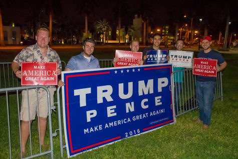 The FAU College Republicans display signs supporting Donald Trump before the start of the third presidential debate. Craig Ries | Contributing Photographer