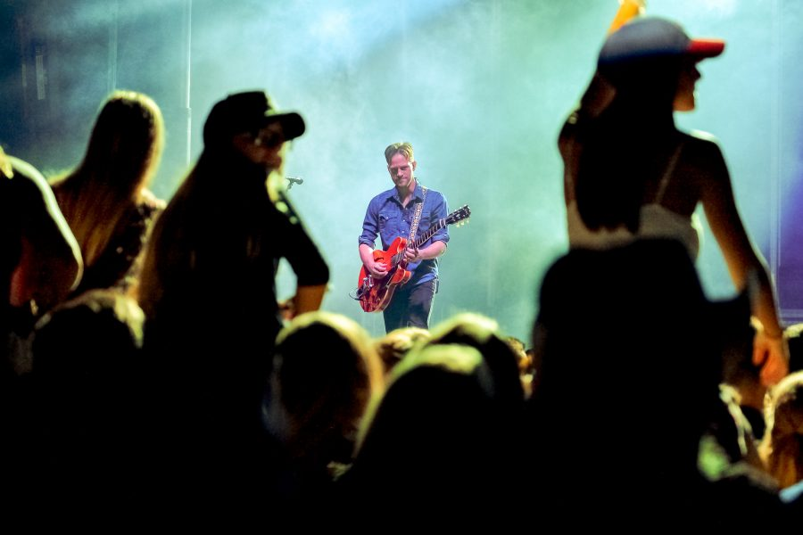 Chase Bryant's guitarist performs while Bryant sings during the 2016 Bonfire concert Monday. Mohammed F Emran | Contributing photographer