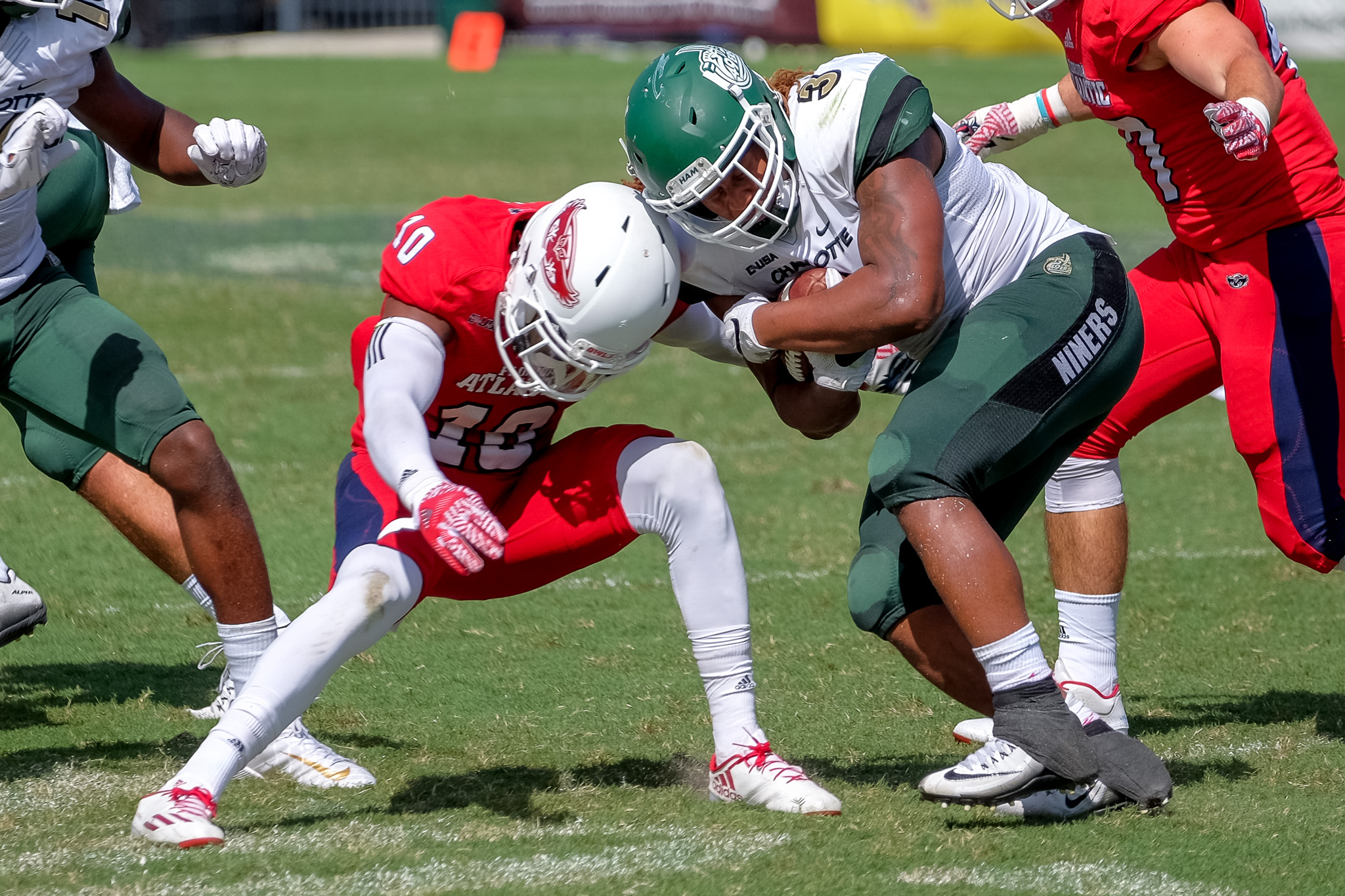 FAU sophomore cornerback Herb Miller (10) tackles 49ers running back Kalif Phillips (3).