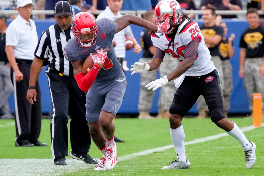 Hilltoppers junior strong safety Leverick Johnson (29) pushes Owls redshirt junior wide receiver Kalib Woods (4) out of bounds. Mohammed F Emran | Staff Photographer