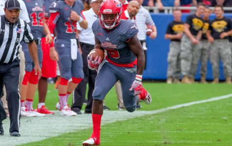 FAU redshirt sophomore wide receiver Bobby Mitchell (8) runs for a first down. Mohammed F Emran | Staff Photographer