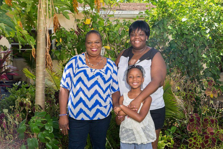 Yolene Joseph with her oldest daughter Astride and her granddaughter McKayla. Brandon Harrington | Staff Photographer