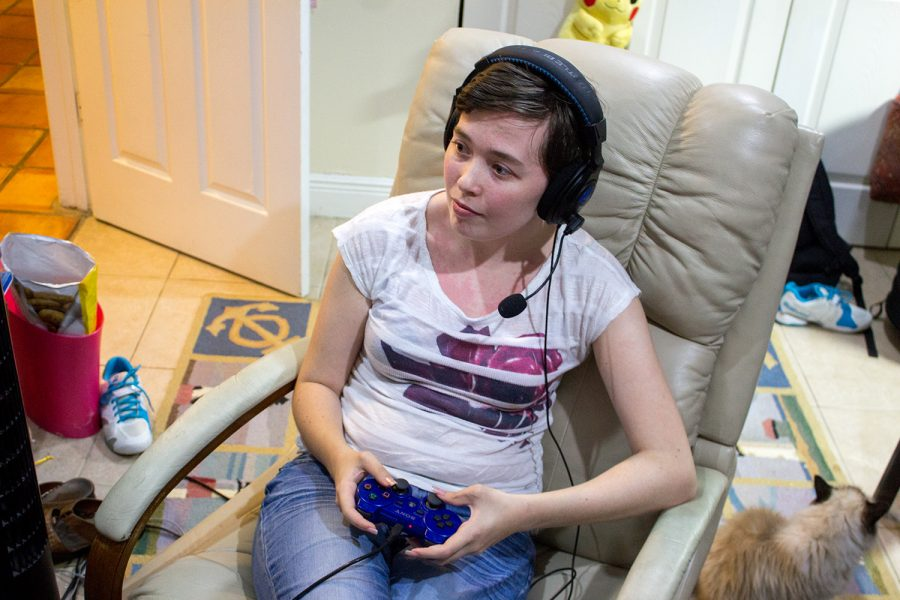 Console gamer and senior elementary education major Jamie Kapp playing Mass Effect 3 online on her Playstation 3 at home. Andrew Fraieli | Managing Editor