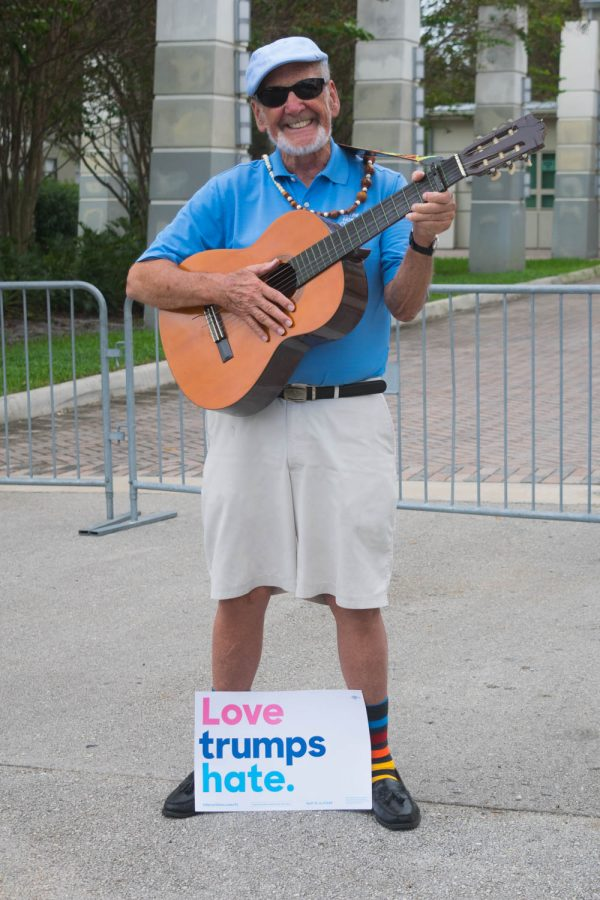 Jack Williams, who calls himself Banjo Jack, stood outside FAU Arena promoting Hillary Clinton to voters who were entering the polls .Ryan Lynch | Editor in Chief