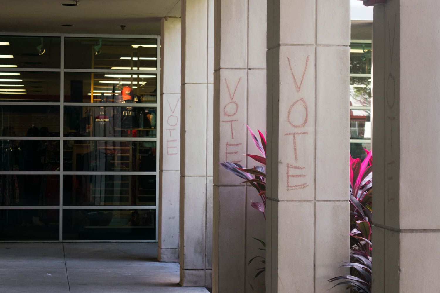 "Pillars near the campus bookstore have the word ""vote"" written in chalk on them a day after the 2016 presidential election. Ryan Lynch 