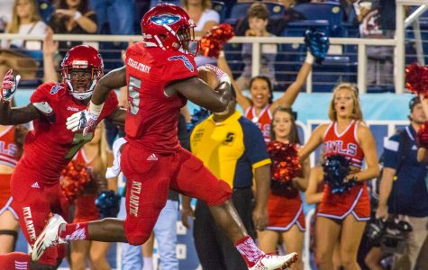 FAU freshman running back Devin Singletary (5) high steps the last 5 yards into the endzone after a 36-yard rush.  Singletary had two touchdowns and 145 yards of rushing on the night.  Max Jackson | Staff Photographer
