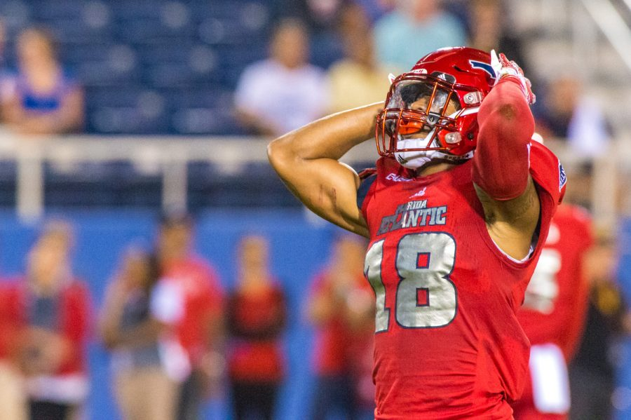 FAU sophomore safety Jalen Young (18) reacts after dropping a punt, which resulted in UTEP regaining possession of the ball. Max Jackson | Staff Photographer