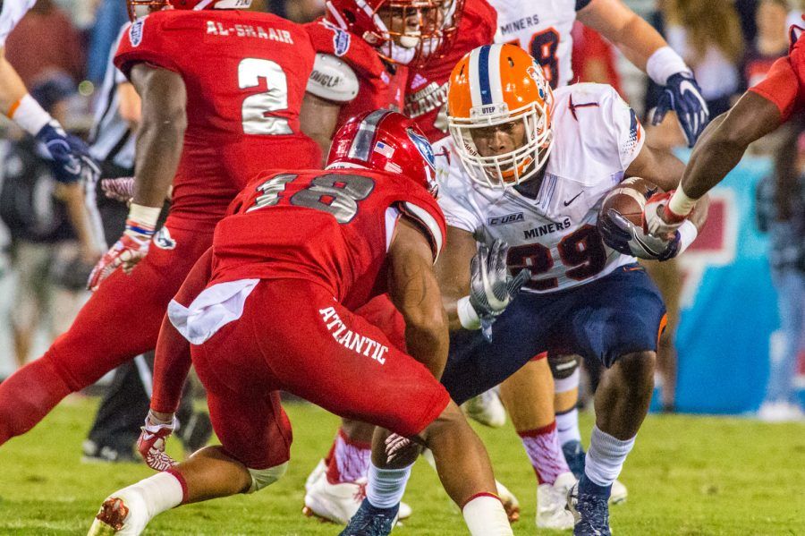 UTEP running back Aaron Jones (29) eyes up Owls safety Jalen Young (18) before being tackled. Max Jackson | Staff Photographer