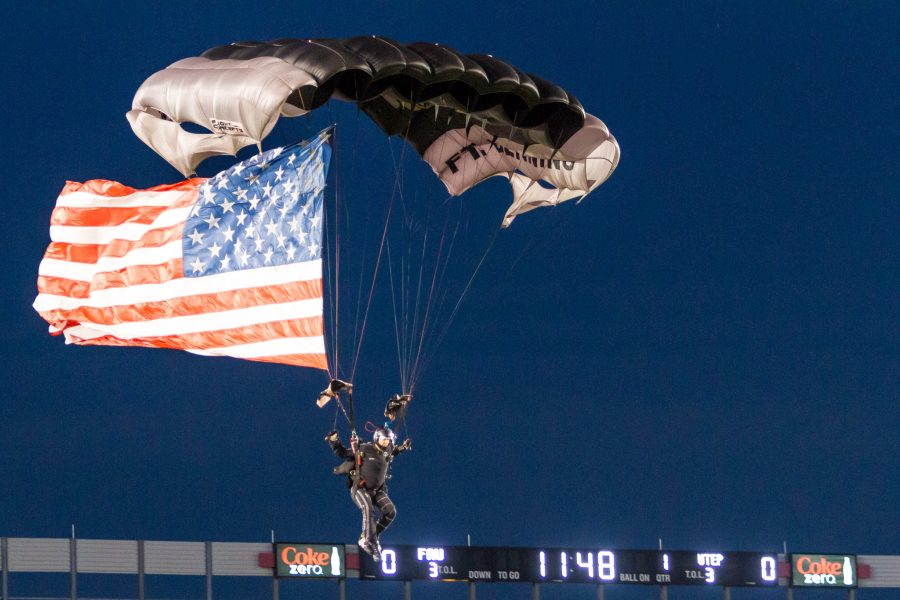 Veteran skydivers opened up the game with American flags and sparklers. Alexis Hayward | Contributing Photgrapher