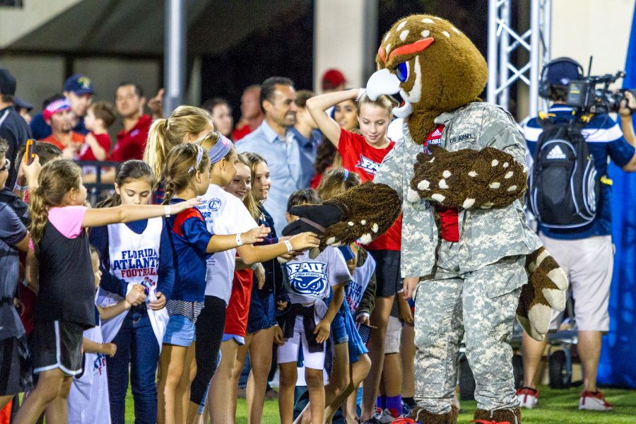 """Owlsley greets kids making a """"high five line"""" before the start of FAU's game versus UTEP. Alexis Hayward 