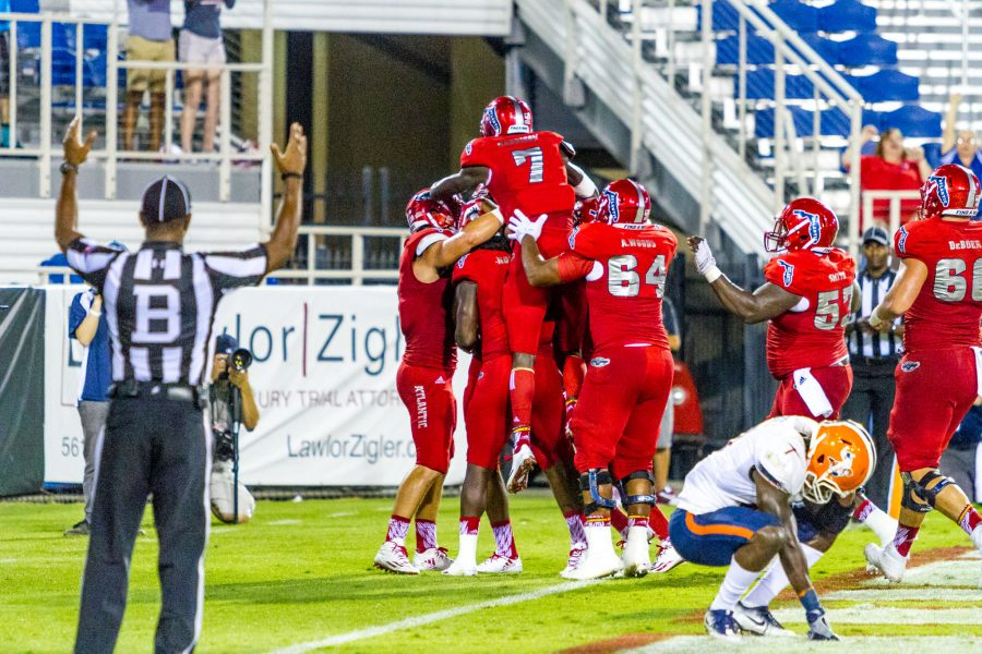 FAU players celebrate in the endzone after the game-winning touchdown by Nate Terry. Alexis Hayward | Contributing Photgrapher