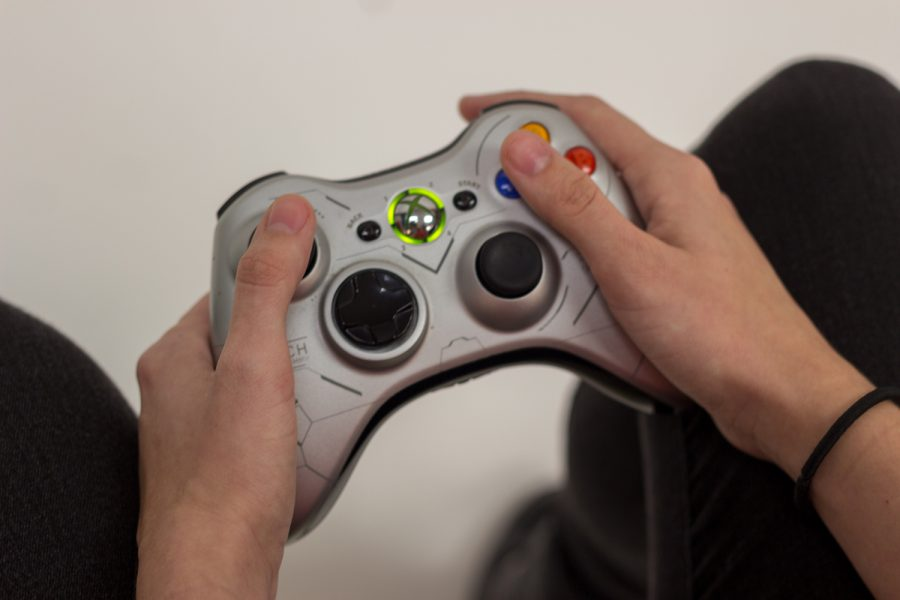 Brittany Ferrendi holds an Xbox 360 controller. Andrew Fraieli | Managing Editor
