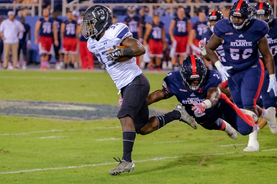 Mohammed F Emran | Staff Photographer FAU sophomore linebacker Azeez Al-Shaair (2) attempts to tackle ODU running back Ray Lawry (33).