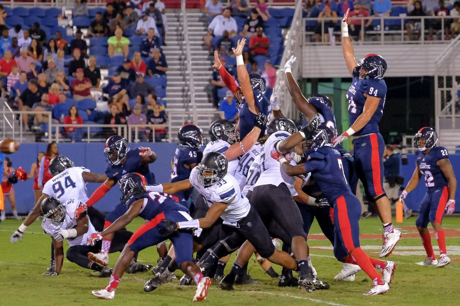 Mohammed F Emran | Staff Photographer Owls attempt to block a Monarchs' field goal which made the score 7-3 in FAU's favor.