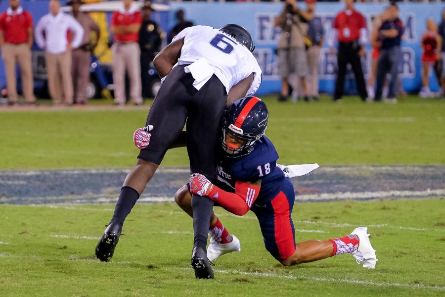 Florida Atlantic sophomore safety Jalen Young (18) tackles ODU wide receiver Zach Pascal (6) at the 30-yard line. Mohammed F Emran | Staff Photographer