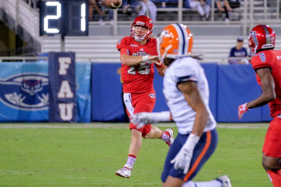 FAU quarterback Jason Driskel (16) looks to pass to an FAU receiver. Mohammed F Emran | Staff Photographer