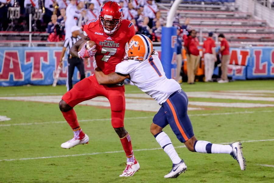 FAU wide receiver Tavaris Harrison (7) is tackled by UTEP defensive back Kalon Beverly (1) at the 7 yard line. Mohammed F Emran | Staff Photographer